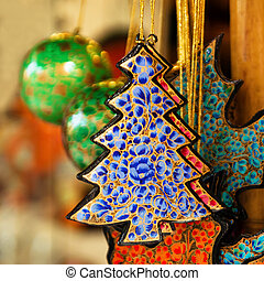 Colorful painted wooden Christmas decorations close-up. Chiang Mai, Thailand.