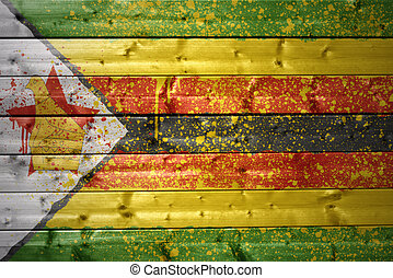 painted zimbabwean flag on a wooden texture - colorful ...