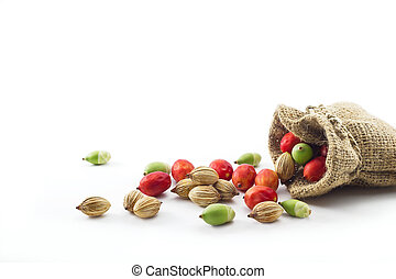 colorful palm seeds in the sack on white background