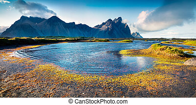 Colorful panorama of the Stokksnes headland on southeastern...