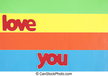 "colorful paper background with word ""love"""