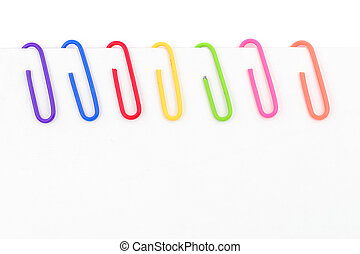 colorful paper clip with whitepaper