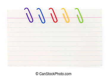 colorful paper clip and notepaper with white background