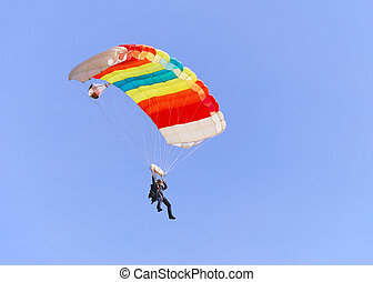 Colorful parachute against clear sky in background.