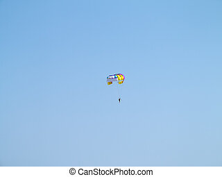 Colorful parachute over blue sky background