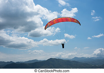colorful paragliding under blue sky