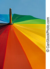 colorful parasol in front of a blue sky