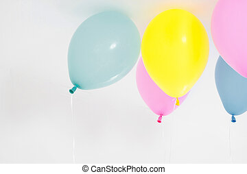 Colorful party balloons background. Isolated on white. Copy space