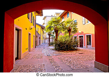 Colorful passage and cobbled street of Cividale del Friuli,...