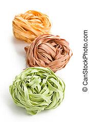 colorful pasta tagliatelle on white background