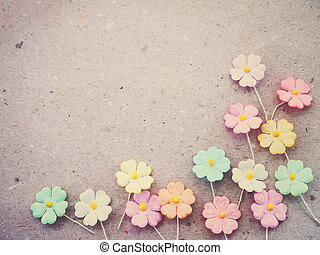 Colorful Pastel Artificial Flower On Recycled Paper Background