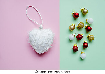 Colorful pastel Chrstmas decoration balls on pink background. New year concept with creative copy space. Minimal colorful Christmas baubles on pastel background Holiday concept. Flat lay.