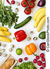 Colorful pattern of health food on a white wooden background. Healthy eating. Top view. From above. Flat lay.