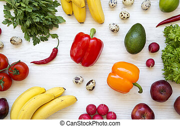 Colorful pattern of health food on a white wooden table. Healthy eating. Top view. From above.