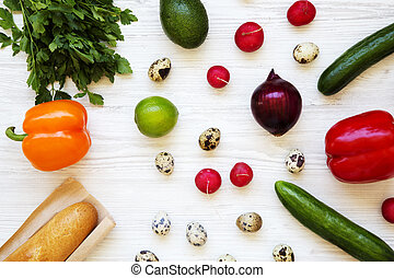 Colorful pattern of healthy food on a white wooden background. Top view. From above.