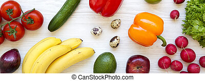 Colorful pattern of healthy food on a white wooden surface. Healthy eating. Top view, overhead. From above. Flat lay.