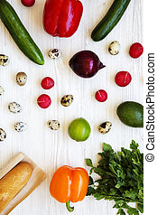 Colorful pattern of healthy food on a white wooden table, top view. From above, overhead.