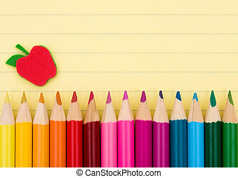 Education background - Colorful pencil crayons on a sheet of...