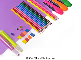 colorful pencils and neon pens on mauve paper and white background