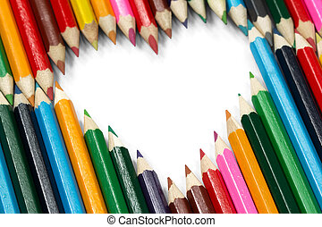 Colorful pencils forming a flying heart shape