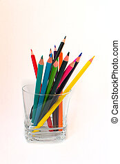 colorful pencils in a transparent glass