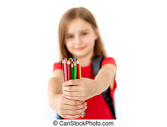 Colorful pencils in little girl hands