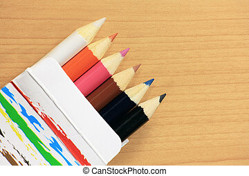 Colorful pencils in paper box