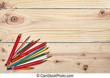 Colorful pencils on a wooden talbe