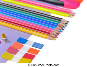 colorful pencils, post it and pens on mauve paper and white copy space