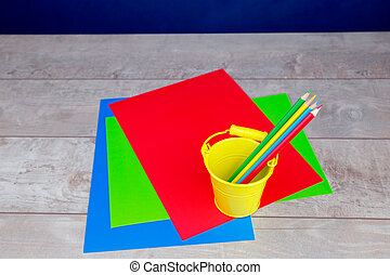 Colorful pencils, stationery on wooden desk