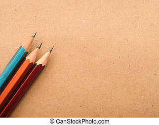 colorful pencilsl on brown packing paper background, carton ...