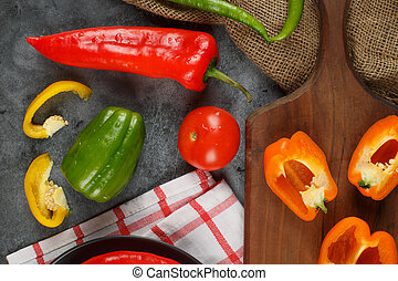 Colorful peppers on a wooden board. Top view.
