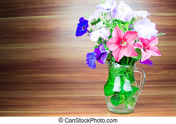 Colorful petunia blooms in pitcher