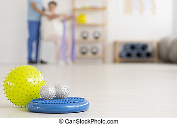 Colorful physiotherapy equipment on floor