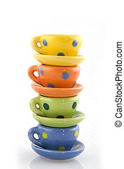 cups and saucers - colorful piled cups and saucers