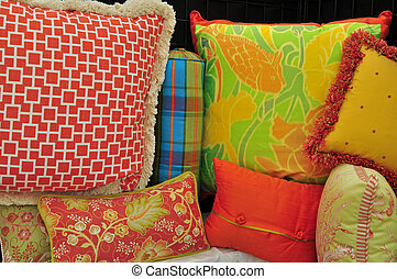 a display of colorful throw pillows