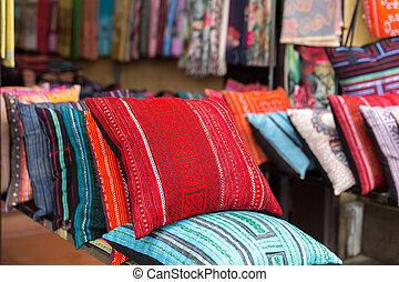 Colorful pillows at sales counter at asian market