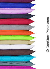 Stack of bright pillows on white background
