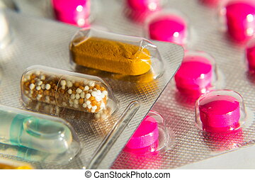 Colorful pills in transparent medicine capsule, nanotechnology future medicine concept