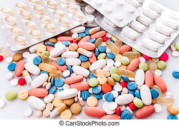 Colorful pills on a white background