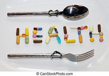 """Colorful pills - Word """"health"""" inlaid with colored pills"""