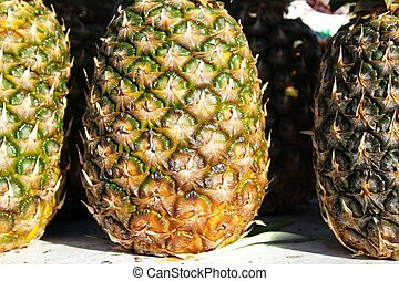 Colorful pineapples at a market stall
