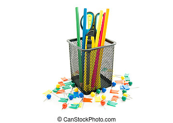 colorful pins and other stationery on white closeup