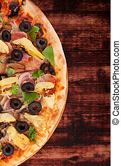 Colorful pizza on dark wooden background.