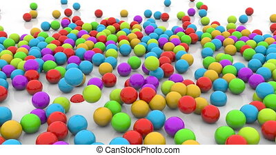 Colorful plastic balls dropped time lapse footage