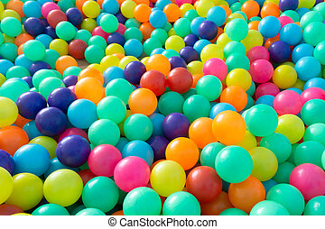 Colorful plastic balls for children playing in playground room