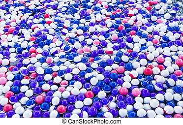 Colorful plastic balls in the pool