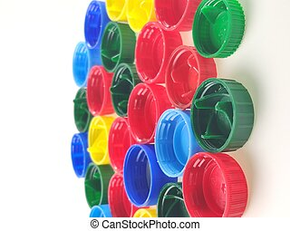 colorful plastic caps on white background, top view
