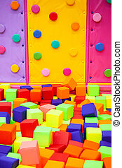 colorful plastic cubes on children's playground and kids bouldering