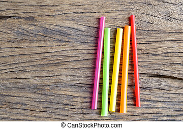 drinking straw - colorful plastic drinking straw on wooden...